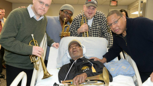 JLCO with Wynton Marsalis and Cécile McLorin visiting Clark Terry in the hospital