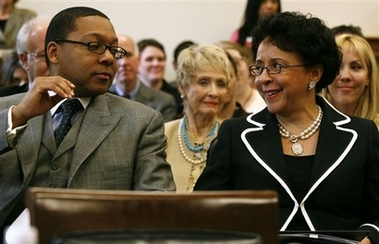 Wynton Marsalis is congratulated by Sheila C. Johnson
